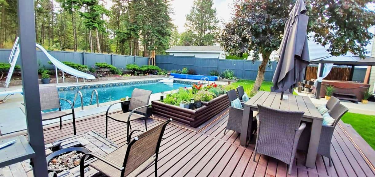 Your Backyard Retreat #poolside #firepit #hottub #barbecue #summertime