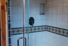 Glas Enclossed Tile Shower with Large Shower head and