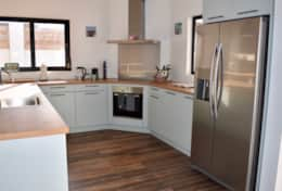 Fully equipped European kitchen with Nespresso machine, kettle, dishwasher, microwave, toaster and d