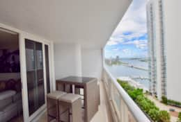 Furnished baclony with biews of Biscayne Bay, Miami Beach, downtown Miami