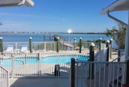 Enjoy the sunrise from the dock, pool, or home!