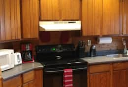 kitchen,copper ceilings, wood cabinets, pots, pans,utensils provided