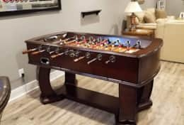 Electronic cherry wood foosball table for some healthy competition.