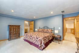 Upper level 'second master' features a king size bed and attached bonus room