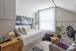 Attic bedroom (may be uncomfortable at times for sleeping during warmer months / periods - we do not