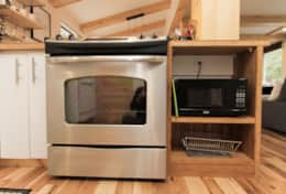 Kitchen features stainless steel appliances including stove, oven, refrigerator, microwave & toaster