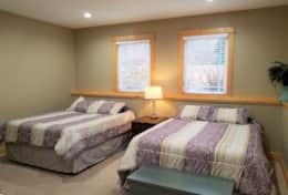 Lower level bedroom #1 with two queen size beds and spacious walk-through closet.