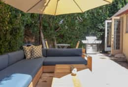 Huge patio with sofa, umbrella and BBQ
