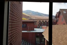 view of ski slopes from window on studio side