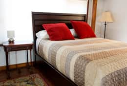 Queen size bed in the second bedroom.