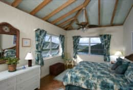 Master King-sized bedroom with views of Mamey Peak and Coral Bay