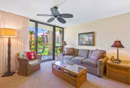 Living Room opens to the lanai and beautiful court views