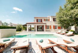 Villa Alma vacation: stone terrace with outdoor swimming pool