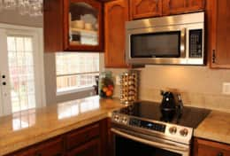 Cooking area with smooth top electric range and microwave