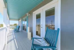 First and Second master bedroom walkout covered deck with multiple ocean views.