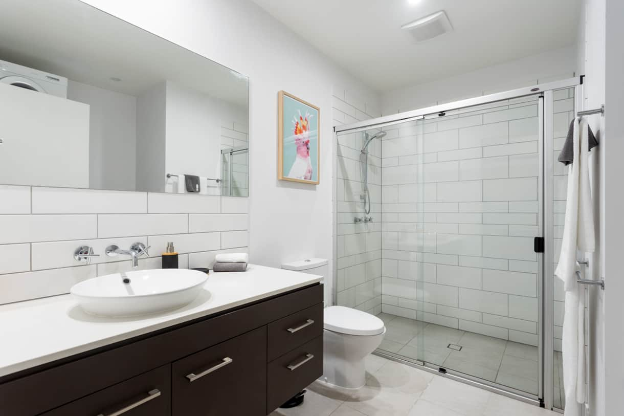 Downstairs bathroom with laundry facilities