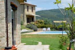 The cottage, the pool and the main villa