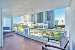 Fully furnished balcony with views of Biscayne Bay, Margaret Pace Park and Heart Island