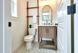 Main floor powder room with cement tile floors.