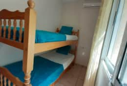 Bedroom # 3 with bunk beds and air conditioning