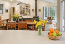 Open inviting kitchen to lounge - The River House Gipsy Point - Good House Holiday Rentals