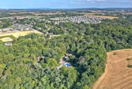 A look from above at your private wooded estate.