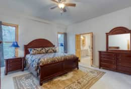 Spacious main floor master with a comfortable king size bed and ensuite bathroom