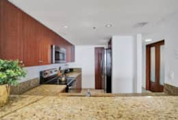 Fully equipped kitchen with seating for 3 at kitchen counter