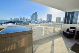 Fully furnished balcony with views of Biscayne Bay and Downtown Miami