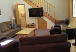 cabin 12 front room half bath gas fireplace 3 lazy boy reliners smart tv and queen sleeper sofa