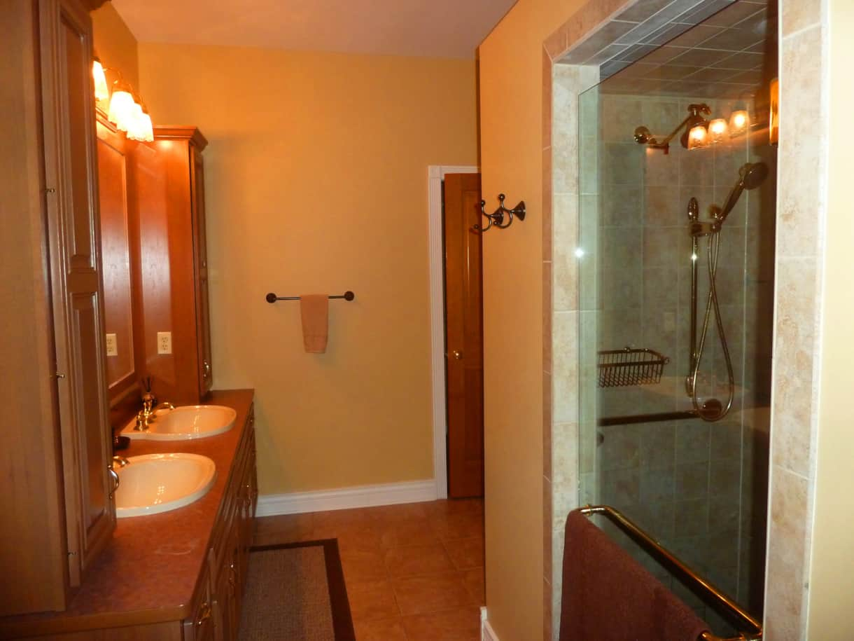 Master bath with wheelchair accessible shower.