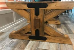 Dining table trestle base is made of pine.  The middle beam is solid poplar.
