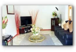 Sitting Room Area Displaying a 48 inch Flat Screen Smart TV and Entertainment center