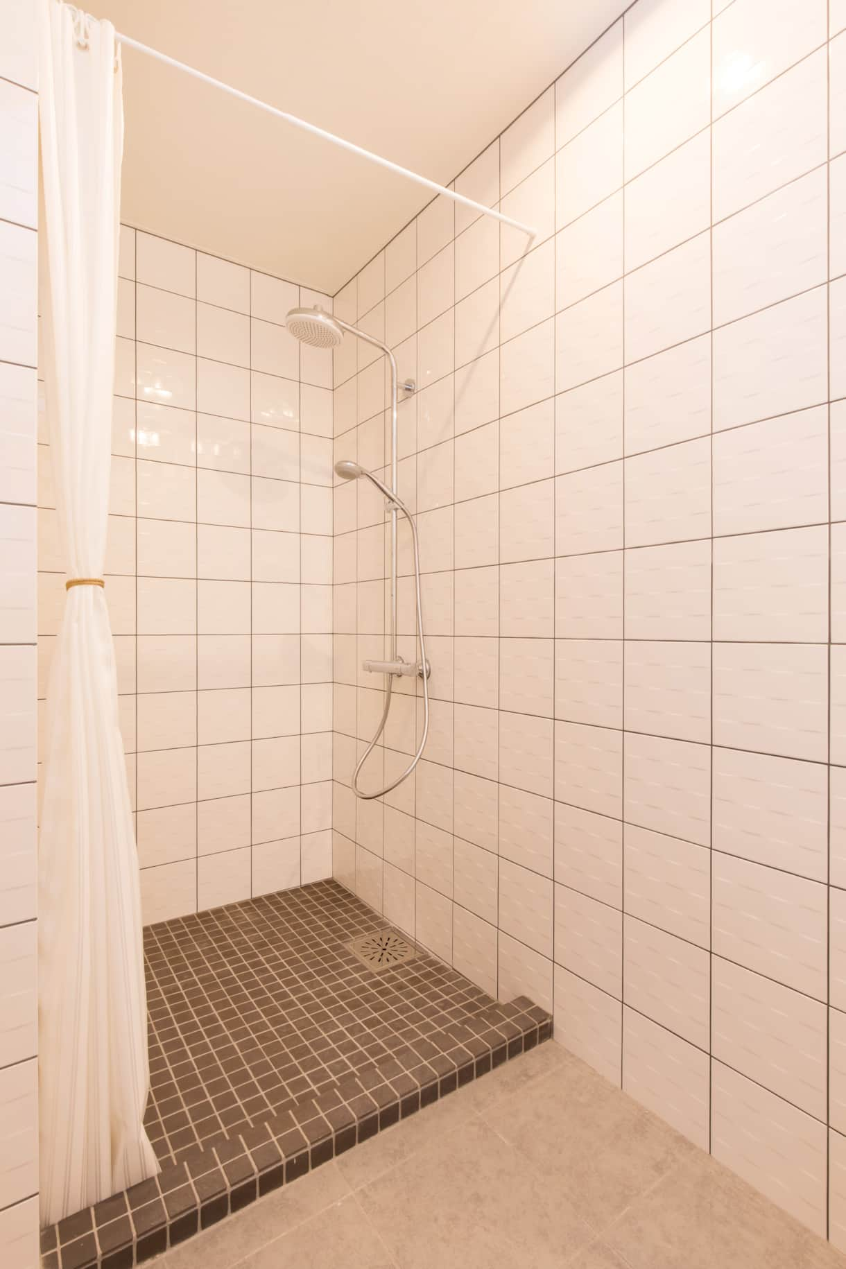 Large fully tiled shower room