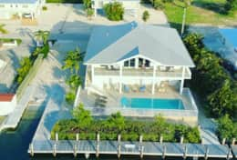 Aerial of Grouper House, pool, dock and ramp
