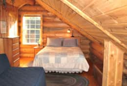 Upstairs Loft has 1 Queen Bed, 2 Singles and 3/4 Bathroom