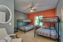 2nd main floor bedroom is located next to master and has 2 twin over full bunks.