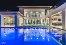float under the stars in the lavish pool area