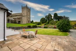 Outdoor seating with views of the church and countryside