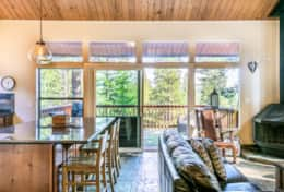Living, kitchen and deck with peek lake views