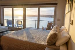 Luxury Lookout Canal-Vacation Rental Sunset Bedroom
