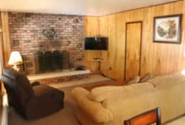 cabin one queen sleeper sofa brick fireplace living room