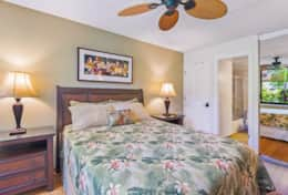 The master bedroom ensuite has a comfy queen bed with full bathroom and more local art.