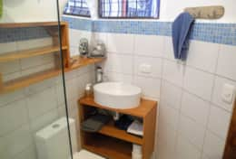 Palma has a petite and clean bath with walk in shower and hotwater.