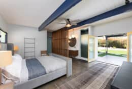 Master bedroom with King bed and opens directly to the backyard/pool.