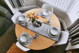 Beautiful dining table situated in the bay window with lovely views