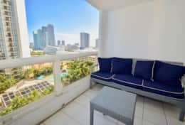 Furnished balcony with views of Biscayne Bay and Downtown Miami