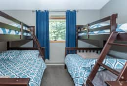 The kids room has two single over double bunk beds!