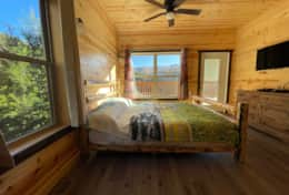 Main Bedroom with king size bed and acces to the deck