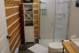 Bright shower, storage space, towel hooks and a valuables safe